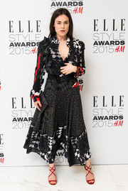 Tallulah Harlech looked bold and chic in a ruffle-accented mixed-print dress at the Elle Style Awards.