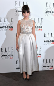Daisy Lowe went for edgy elegance at the Elle Style Awards in a pale-gray Giles Deacon gown with a distressed bodice and a full skirt.