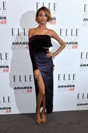 Jourdan Dunn looked fabulous at the Elle Style Awards in this Emilio de la Morena one-sleeve number, featuring a plum velvet bodice, a slashed waist, and a jacquard skirt with a high slit.