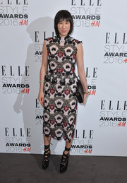 Eva Chen worked some heavy embroidery in this Erdem midi dress at the Elle Style Awards.