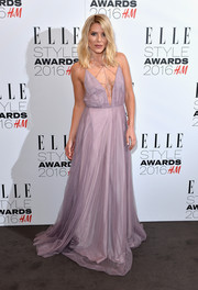 Mollie King looked like a princess gone wild in her lavender Topshop gown, boasting a plunging, strappy neckline and a floor-sweeping hem, at the Elle Style Awards.