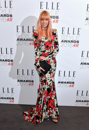 Amber Le Bon chose an embroidered black velvet clutch to pair with her dress.