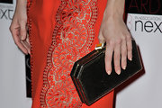 Kate Hudson gave her ultra feminine evening dress a hint of punk edge with a shimmery hard case clutch.