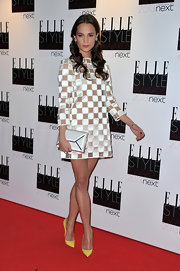 Alicia jumped in on the LV love in yet another checkered mod dress at the Elle Style Awards.