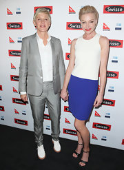 Portia de Rossi chose this white and purple color-blocked frock for her appearance at wife, Ellen DeGeneres' arrival party in Australia.