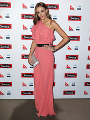 Rebecca Judd chose a salmon pink, one-shoulder dress with a ruffled top and flowing skirt for her look at Ellen DeGeneres' Australia Party.