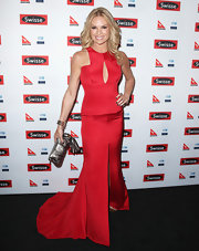 Sonia Kruger donned a satin mermaid gown with a keyhole cutout and front slit.