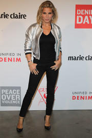 Elsa Pataky added a dose of shine with a silver varsity jacket.
