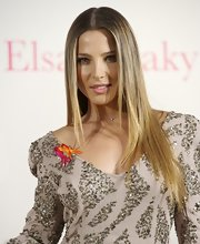 Elsa Pataky styled her hair in a straight center part hairstyle that was sleek and polished.
