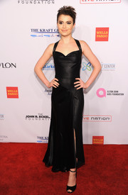 Sami Gayle opted for simple black ankle-strap sandals to complement her dress.