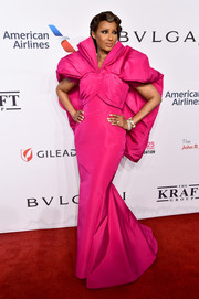 Iman dropped jaws in a dramatic caped fuchsia gown by Zac Posen at the 2018 Enduring Vision benefit.