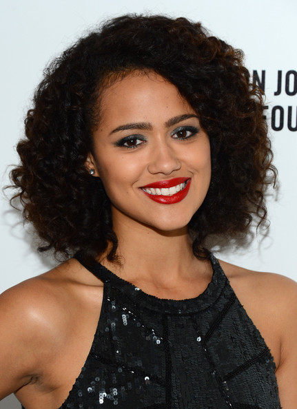 Nathalie Emmanuel sported high-volume curls at the 2014 Elton John AIDS Foundation Oscar-viewing party.