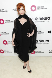 Christina Hendricks added a bit of drama to her LBD with a sheer black cape.
