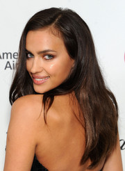 Irina Shayk left her long hair loose with a side part when she attended the Elton John AIDS Foundation Oscar viewing party.