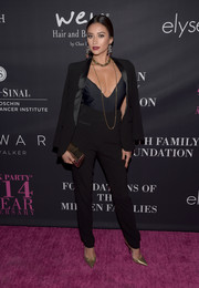 Shay Mitchell added shine to her all-black outfit with a pair of gold pumps.