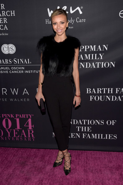 Giuliana Rancic teamed super-chic Louboutin lace-up pumps with a fur vest for the Pink Party.