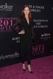 Marcia Cross went the modern route in a black sheer-panel coat dress teamed with leggings during the Pink Party.