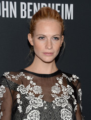 Poppy Delevingne pulled her hair up in a messy-chic bun for the Pink Party.