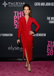 Kate Beckinsale looked fiercely chic at the Pink Party in a long-sleeve red Donna Karan dress with a thigh-high slit.