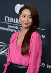 Brenda Song wore her super-long hair sleek straight for the Pink Party.