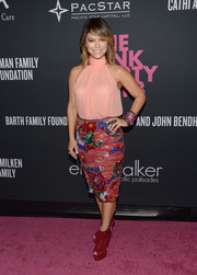 Elyse Walker looked very girly in a pink halter top and a colorful beaded skirt during the Pink Party.