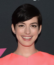 Anne Hathaway wore her short hair with a deep side part when she attended the Pink Party.