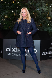 Emma Bunton switched on the Christmas lights at the Royal Exchange wearing a navy tweed coat with gold buttons.