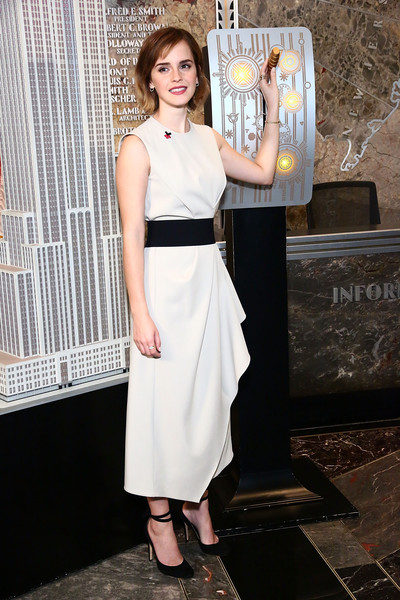 Emma Watson kept it demure and classy in a sleeveless LWD with a draped skirt for the HeForShe International Women's Day event.