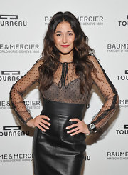 Emmanuelle Chriqui flaunted her lace bra with a sheer black pin dot blouse.