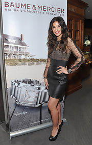 Emmanuelle Chriqui toughened her sheer lacy blouse with a high-waist leather pencil skirt.