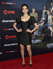 Emmy Rossum complemented her dress with black ankle-strap pumps by Jimmy Choo.