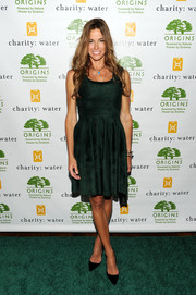 Kelly Bensimon sported a girly silhouette in a moss-green fit-and-flare dress during the Origins Smartyplants event.