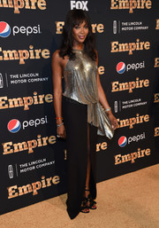 Naomi Campbell dazzled at the 'Empire' season 2 premiere in a halter gown with a draped silver bodice and a high-slit black skirt.