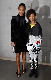 That's right, kids, Willow Smith is wearing black-and-white lace-up leg warmers (they look like Converse!) with her black combat boots!