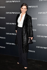 Juliette Binoche looked perfectly polished in a textured coat layered over a white shirt and black pants at the Emporio Armani fashion show.