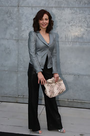 Violante Placido arrived at the Emporio Armani show holding an oversized snakeskin clutch.