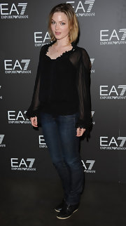 Holliday Grainger wore a blouse and jeans ensemble at the summer presentation of Armani's collection.