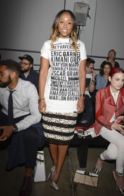 Shiona Turini attended the En Noir fashion show wearing a statement-making tee designed by Pyer Moss.