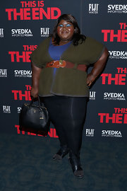 Gabourey Sidibe chose a forest green cardigan for her look at the premiere of 'This is The End.'