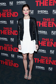 Hilary Rhoda chose a black leather jacket to pair over a fun and flirty dress for a cool mix of styles.