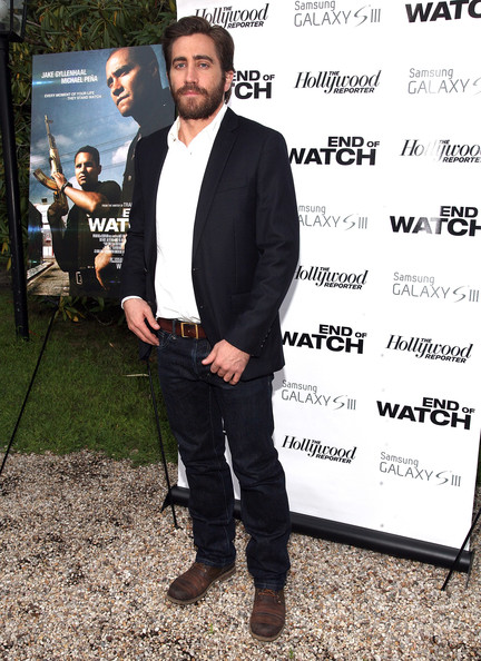 Jake Gyllenhal roughed up his jean, blazer, and button-up combo with  distressed brown leather lace-ups.