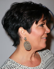 Kris Jenner showed off her sparkling diamond drop earrings while attending a store opening in LA. Kis always look perfectly chic.
