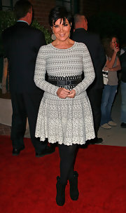 Kris wore an intricate print long sleeve dress with a black belt, tights and pumps. Just the Kardashian style!