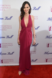 Nicole Trunfio showed some skin with this pink evening gown with gathered waist.