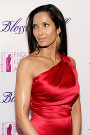 Padma Lakshmi's gold chandelier earrings and red one-shoulder gown at the Blossom Ball were an ultra-sophisticated pairing.
