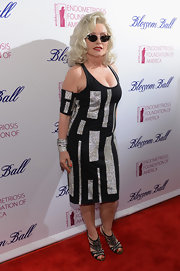 Debbie Harry stayed true to her rocker style with this black and silver geometric shape dress.