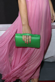 Eve Hewson sported a bold color mix at the 'Enough Said' screening with this green leather clutch and pink dress combo.
