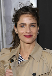 Amanda Peet sported a wind-blown ponytail at the New York screening of 'Enough Said.'