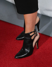 Toni Collette stepped out on the 'Enough Said' red carpet wearing edgy black ankle boots by Sigerson Morrison.