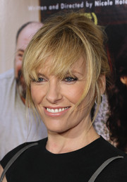 Toni Collette walked the red carpet wearing a messy updo during the New York screening of 'Enough Said.'